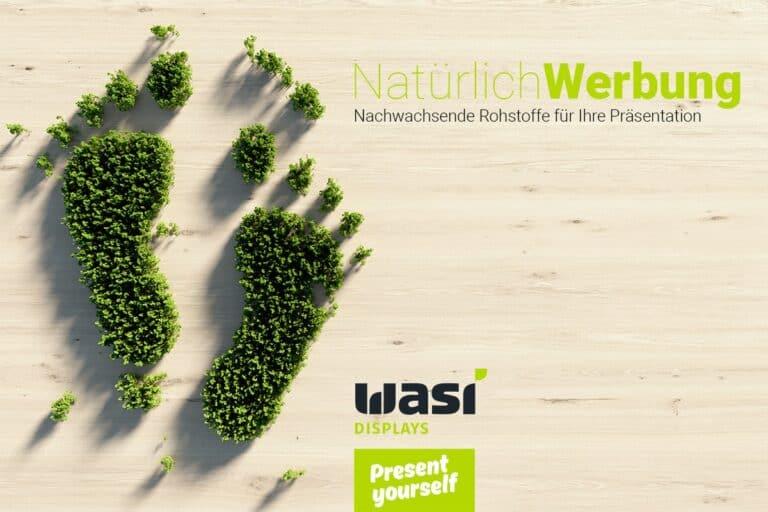Slider mit Aufschrift und zwei Füßen aus Bäumen als Symbol für nachwachsende Rohstoffe